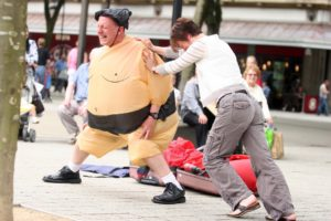 David Price dressed as a sumo wrestler as part of his science made simple busking session held in Vicoria Sqaure in Bolton. 04/07/09